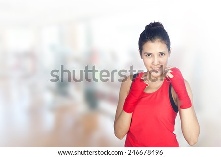 portrait of young beautiful woman 20 - 30 year old during fitness time and exercising in gym - stock photo