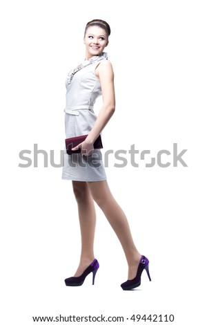 Portrait of young beautiful women with her handbag. Isolated on white background - stock photo