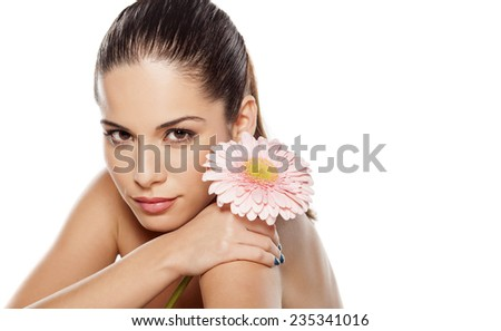 Portrait of young beautiful young woman with gerbera - stock photo