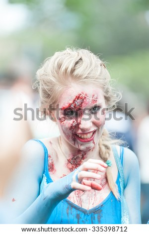 Portrait of young beautiful zombie lady at Sydney Zombie Walk in Sydney, AU, 31st October, 2015. Annual event where thousands of people get involved to raise awareness for Australia's Brain Foundation - stock photo