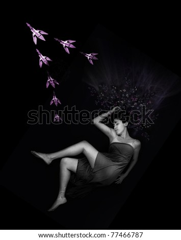Portrait of young beauty dreaming with a flock of origami birds flying - stock photo
