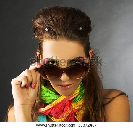 Portrait of young beauty in big sunglasses
