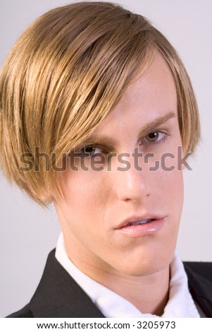 Portrait of young blonde male with intense look