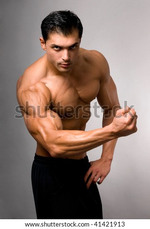 Portrait of young bodybuilder man.