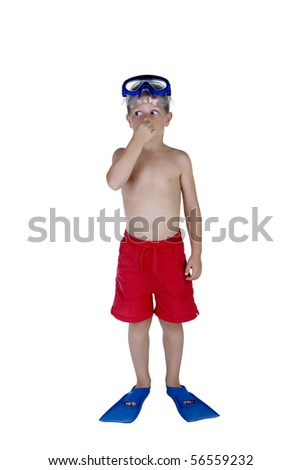 Portrait of young boy in swimsuit and snorkeling gear holding his nose, studio shot - stock photo