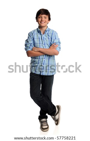Portrait of young boy standing with arms crossed - stock photo