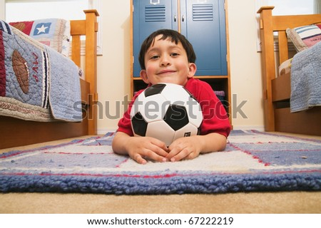 Portrait of young boy with soccer ball