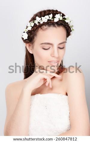 Portrait of young bride in wedding dress, studio shot - stock photo