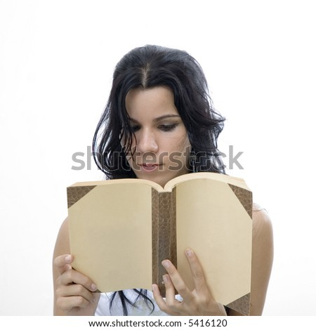 Portrait of young brunette girl reading a book - isolated over white