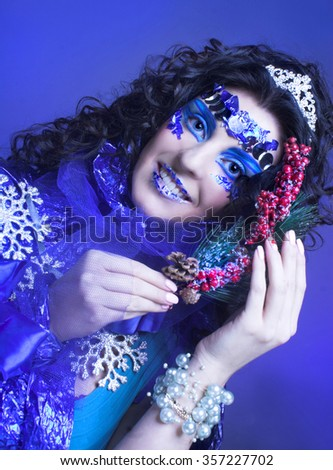 Portrait of young brunette in creative carnival image.
