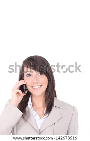 Portrait of young brunette with telephone - stock photo