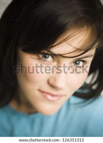Portrait of young brunette woman smiling - stock photo