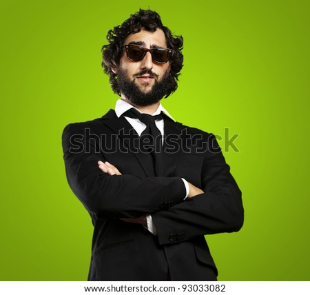 portrait of young business man against a green background - stock photo