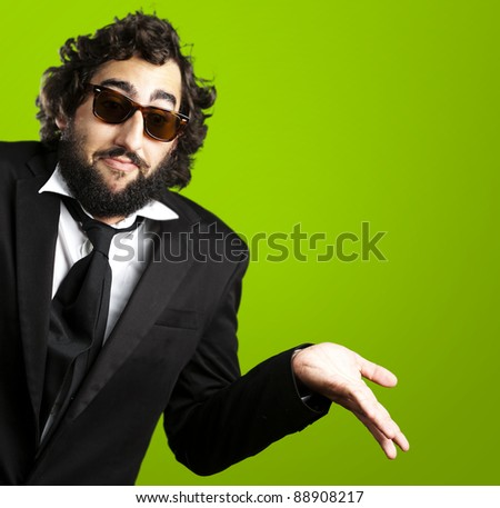 portrait of young business man confused against a green background