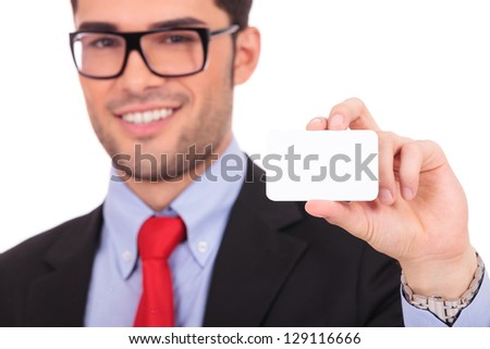 Portrait of young business man isolated on white background. Holding blank business card and smiling - stock photo
