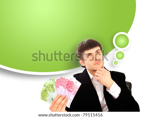 Portrait of young business man isolated on white background. Holding money in his arms - stock photo