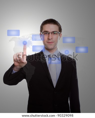 Portrait of young business man pressing modern buttons on a virtual background - stock photo
