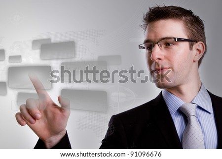 Portrait of young business man  pushing a button on a touch screen interface - stock photo