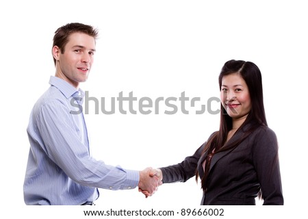 Portrait of young business man shaking hands with a young business  woman against white background