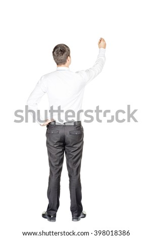 portrait of young business man standing back to camera writing with marker on white background.  isolated on white background. business and lifestyle concept
