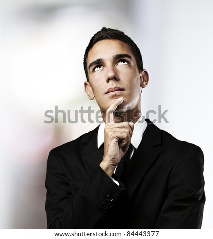 portrait of young business man thinking in a house - stock photo