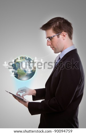 Portrait of young business man using a touch screen device - stock photo
