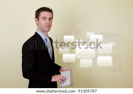 Portrait of young business man using a wireless keyboard for presentation - stock photo