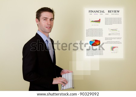 Portrait of young business man using a wireless  keyboard presenting financial review - stock photo