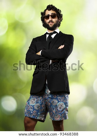 portrait of young business man wearing swimsuit against a nature background - stock photo