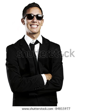 portrait of young business man with suit and sunglasses against a white background - stock photo