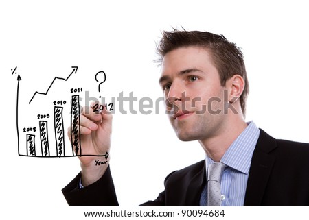 Portrait of young business man writing financial graph against white background - stock photo