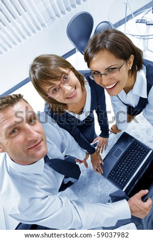 Portrait of young business people  discussing project in office environment - stock photo