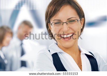 Portrait of young business people  getting busy  in office environment - stock photo