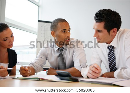 Portrait of young business people in a meeting - stock photo