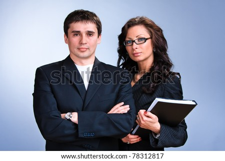 Portrait of young business people with documentations - stock photo