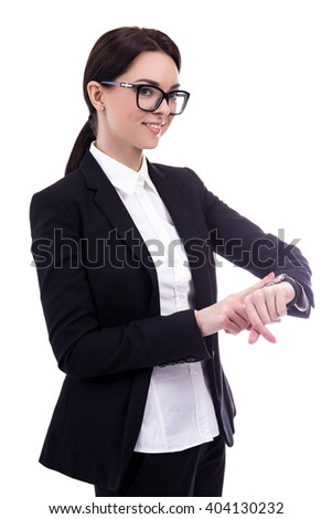 portrait of young business woman checks time on her wrist watch isolated on white background - stock photo