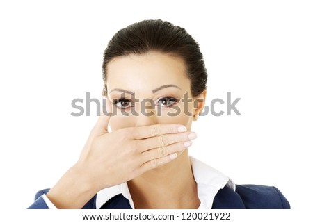 Portrait of young business woman covering with hand her mouth, isolated on white background - stock photo