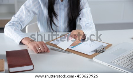 Portrait of young business woman holding blank white business card