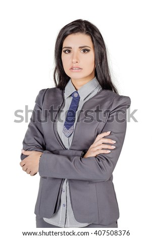 portrait of young business woman in gray suit with crossed arms. isolated on white background. business and lifestyle concept - stock photo