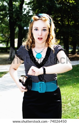 portrait of young business woman in park - stock photo