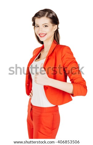 portrait of young business woman in red suit making thumbs up sign. isolated on white background. business and lifestyle concept - stock photo