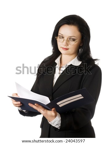 Portrait of young business woman reading documents - stock photo