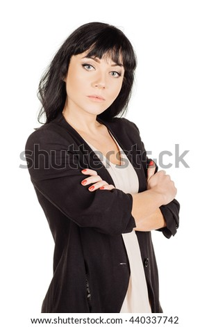 portrait of young business woman with crossed arms. isolated on white background. business and lifestyle concept