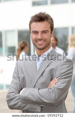 Portrait of young businessman - stock photo