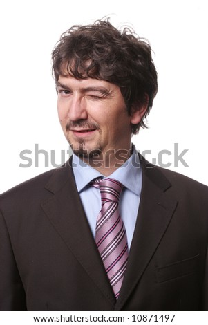 Portrait of young businessman, blinking an eye and isolated on white background