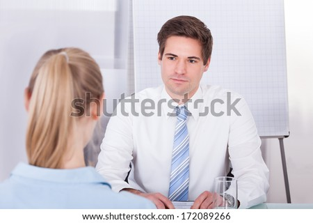 Portrait Of Young Businessman Conducting Interview In Office - stock photo