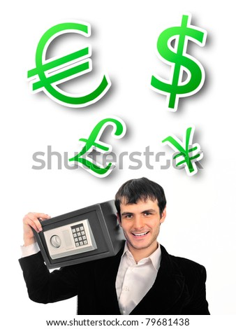 Portrait of young businessman holding metal safe. He looks confident and happy - stock photo