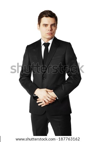 Portrait of young businessman in black suit