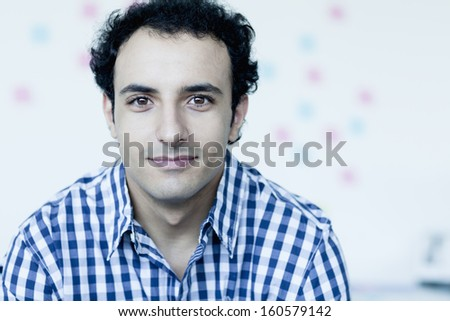 Portrait of young businessman in checkered shirt - stock photo