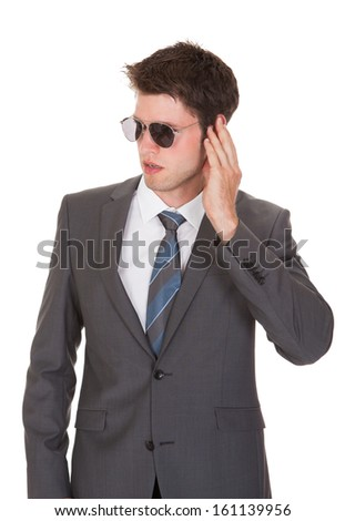 Portrait Of Young Businessman Isolated On White Background - stock photo
